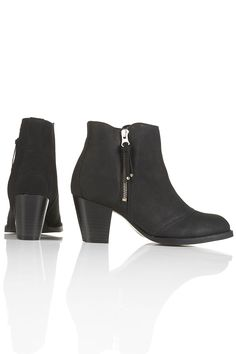 """Topshop mighty black leather zip boots. Heel 2.5"""". 100% leather upper. Imported. $90."""