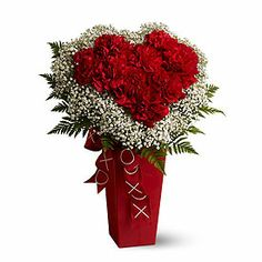 """A. Johnson & Sons Florist: Heart And Soul bouquet. When you send someone this soulful flower arrangement, there'll be no mistaking that you're giving them your heart! A heart made entirely of red carnations is nestled in a cloud of baby's breath and presented in a tall red vase. A pretty ribbon completes this charming gift. Approx. 16""""H X 11""""W"""