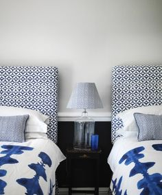 Quadria Fabric A bold fabric with a Mediterranean feel, featuring a mid scale geometric design of circles and diamonds, shown in white and ink blue.