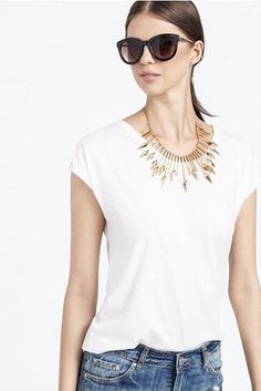 This spiked gold necklace makes even jeans and a t-shirt look amazing. | 23 Statement Necklaces That Make Any Outfit Look Like You Tried