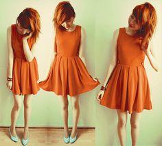 Orange dress with turquoise pumps.