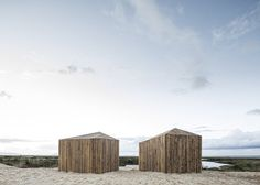Vorm - tweeling - Waterfront cabins in Grândola, Portugal, by Aires Mateus built from reclaimed wood, prefabricated off-site and transported on a lorry.