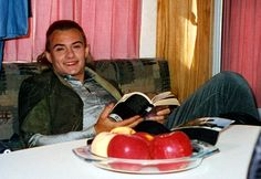 Orlando on a break during filming, reading in his trailer