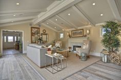 I love the beachy-cool feel of this Newport Beach living room. Cerused floors and exposed beams totally make the room.