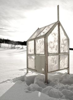 A tiny house/cabin with walls and windows made of ICE