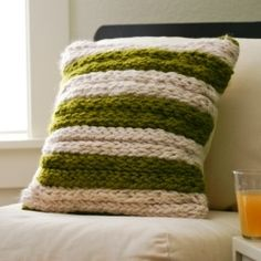 Intimidated by knitting? Forget about it! Finger-knit this modern chunky throw pillow, or let your six year old do it! crafts