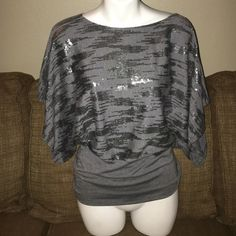 Lipstick Top A really cute size small top by the Lipstick brand...it's charcoal gray with metallic silver sequence details on the front!! It's also got wide open arm holes and a fitted waist area it's in excellent condition from a smoke free house Lipstick  Tops