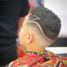 """Z"" shaped hard part on a faux hawk with a medium fade"