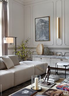 Luxury living room | modern furniture pieces, marble sideboard , and gold wall lamp| http://www.bocadolobo.com/en/ #contemporarydecor #moderninteriordesign