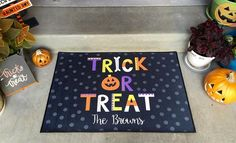 Welcome your trick-or-treaters at your front door this Halloween with our festive personalized Halloween Door Mats.