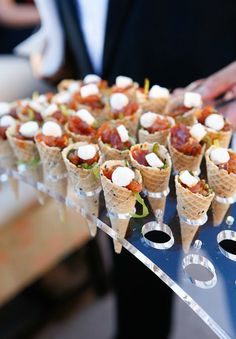 If you're not just any bride then you probably want a unique way to serve guests some great food, right? No tallying of chicken vs. beef or fretting about how to decorate the buffet table, 'cause we've got 23 stylish, sophisticated and downright fabulous food stations to share with you! Let guests feast their eyes on late night noshes, like french fries and sliders to exquisite starters such as oysters and ceviche. Keep the party moving with a theme that suits the bride and groom, if your…