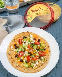 I love making these for a quick lunch, dinner, or healthy appetizer. Quick and easy grilled pita pizza topped with hummus in partnership with Sabra. ~ http://www.halfhersize.com