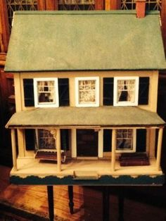 Antique Wooden Dollhouse 1940's Furnished | eBay (Ooh! A porch swing. SK)