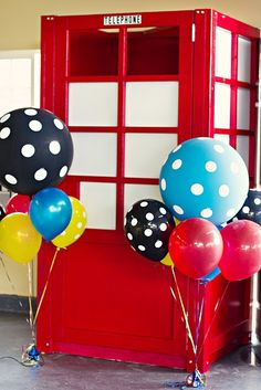 Superhero party idea. Phone booth. See more at www.karaspartyideas.com