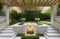 Large blocks of geometric planting are surrounded by varying heights of clipped evergreen and deciduous hedges. A fastigate Carpinus hedge serves as a green wall surrounding the space. -Hollander Design