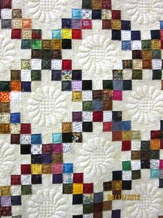 Irish Chain Quilt at Nonnie's Quilting Dreams - this is so beautiful.  Maybe one day my long arm quilting will be more than just randomness.