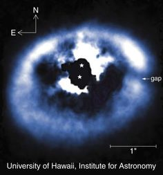 Planet Spotted Forming In Binary System Article at link by Stephen Luntz | Image: University of Hawaii. A wider view of the GG Tauri system, with the stars themselves and masked.