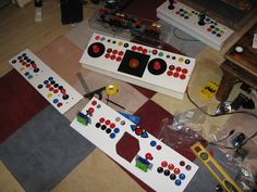 Various Arcade Joysticks in progress of being made. Wife loves it when I do this to her lounge floor!