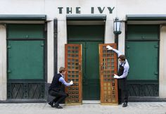 The famous doors of The Ivy are taken by Sotheby's staff for The Ivy Sale on March 25th. All proceeds go to Child Bereavement UK. at The Ivy on February 23, 2015 in London, England. (Photo by John Phillips/Getty Images for The Ivy)