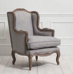 Wing armchair in grey linen