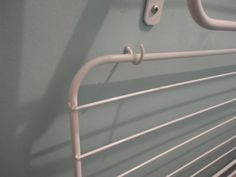 Although the wall mounted drying racks stay up on their own when they're empty, I added these hooks so they'd stay up when full of laundry so I could still get to the back of the cupboard to use the tumble dryer Wall Mounted Drying Rack, Drying Racks, Laundry Cupboard, Drying Room, Laundry Solutions, Skirting Boards, Dehumidifiers, Dryer, Empty