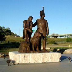 """""""Spirit of Discovery""""  Meriwether Lewis, William Clark  and Seaman   The 14-foot-tall outdoor bronze sculpture at the   Sioux City Lewis & Clark   Interpretive Center."""