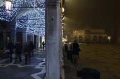 Saint Mark's square on a foggy evening around Christmas