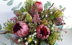 Have you added fresh flowers to your festive season table? A simple mix of red proteas and green foliage is all you need to add a beautiful floral touch to this special day! Visual Display, Fresh Flowers, Special Day, Wedding Bouquets, Floral Wreath, December, Wreaths, Seasons, Texture