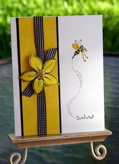 Stamps: Cute as a Bug, Delight in Life Paper: white, black, yoyo yellow Ink: stazon black, yoyo yellow Accessories: ribbon, dimensionals, stickles