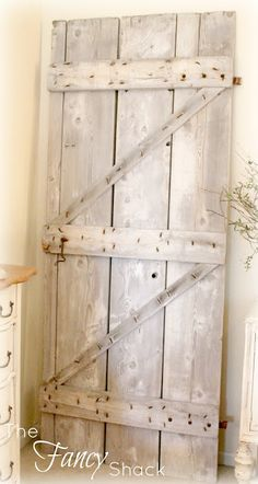 Barn door - possible pantry door idea. Could look really cool with sliders to open the door as opposed to opening outwardly on hinges