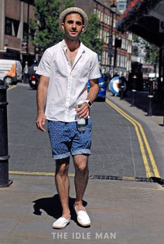 Men's street style | Beach Vibes - Look beachy on the streets in a short sleeve shirt and printed shorts. Don't forget to throw on a bucket hat and a pair of Toms to finish off the look. | Shop the look at The Idle Man