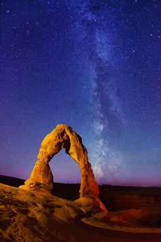 Delicate Arch, and Milky Way stars at Arches National Park, Utah; Photo by: Royce Bair