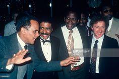 R-L: Gene Wilder; Sidney Poitier; Richard Pryor; listening to Harry Belafonte.; circa 1970; New York.