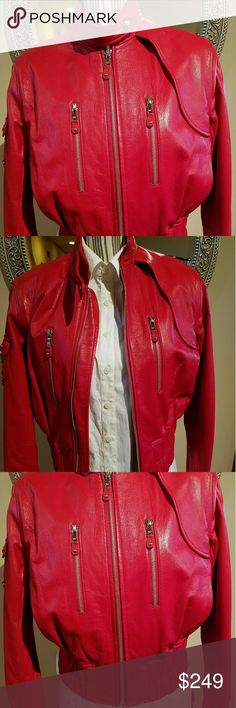 Andrew Marc Moto Red Leather Jacket This is an original Andrew Marc high end motorcycle leather jacket that was given to me as a gift, but never worn. Condition is EUC, inside and out. The red color is vibrant and hot! This is really nice red, thick, soft leather jacket for Fall. I am pretty sure this is considered vintage at this point. Andrew Marc Jackets & Coats