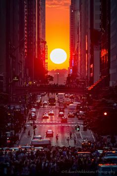 Sunset Manhattan,New York - Twice a year the setting sun aligns perfectly with East-West St  Manhattan - Known as Manhattanhenge -Photo by Eduard Moldoveanu
