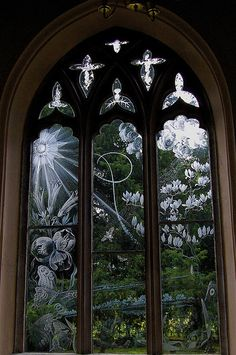 Church windows (Moreton, a village in Dorset, England).  All the windows were designed and engraved by Sir Laurence Whistler over a period of about 30 years,to replace the colored glass panels that were blown out by a bomb in World War II.