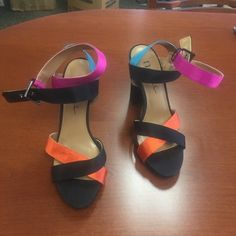 N by Nicole Miller strappy jewel tone heels sz 7 Super cute strappy jewel tone heels by N by Nicole Miller. Black with orange, blue and purple! Size 7 brand new without box. May have been tried on or worn around the house a bit, but never outside. Completely clean bottoms. Nicole Miller Shoes Sandals
