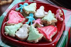 Our World's Best Sugar Cookie Recipe is sure to knock your socks off this Christmas! The combination of the fluffy biscuit-like dough with the super sweet Roll Out Sugar Cookies, Iced Sugar Cookies, Sugar Cookies Recipe, Cookie Recipes, Dessert Recipes, Dessert Ideas, Yummy Recipes, Holiday Baking, Cookies