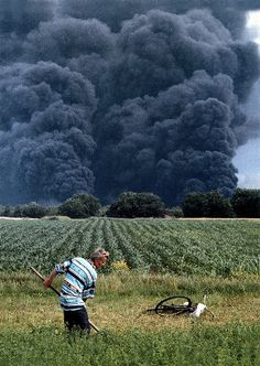 Панчево: A man works the field during the NATO bombing of his country, here targeting the local oil refinery causing it to release toxic clouds that dangerously pollute the air. Oil Refinery, The Locals, Fields, Country Roads, Clouds, Photography, War, Fotografie, Fotografia