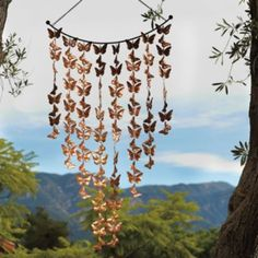 "Butterfly Wind Art - made from copper  23""W x 52""H - not a wind chime, more for the ""fluttering"" of butterflies."