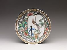 Dish with Birds and Flowers on Fan, ca. 1730–50. Qing dynasty (1644–1911). Porcelain painted in overglaze famille rose enamels and gold (and possibly silver). Diam. of rim: 7 7/8 in. (20 cm). 79.2.590. Purchase by subscription, 1879. © 2000–2012 The Metropolitan Museum of Art.Plate, Meissen, probably 18th century