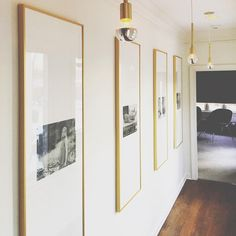 Wow. These pieces certainly make an impact! Horizontal, black and white photos are custom framed in vertical mouldings with super long matboards... Just goes to show - don't let the orientation of the art determine where it will and won't fit. Anything's possible with custom framing!
