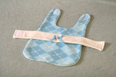 This smart argyle plaid coat is for the lady on the move. Coat is in a blue and cream plaid fleece with a plush cream fleece lining and cream fleece belt. Theres a flirty little blue bow and rosette on the belt.