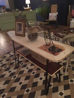 This was a vintage wooden ironing board we found in a friend's garage and turned into a sofa table. I took off the legs and we ordered a set of wrought iron legs off the internet and I added a piece of old barn board for the lower shelf. This one sold quick at our shop Lynthia Designs.