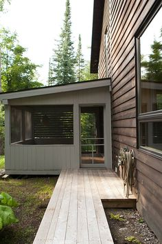 Design of a Nordic and contemporary house in the heart of the forest with a style and conception rooted in the Quebec culture. The expansive decks,. Quebec, Architecture, Tiny House, Garage Doors, Shed, Outdoor Structures, Contemporary, Outdoor Decor, Design