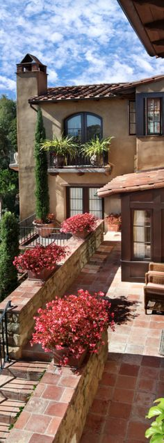 1. Italian style feel from the exterior or architecture of the home, large stones covering the whole patio, warm colors