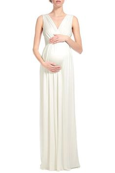 Maternity photo dress. CLASSIC AND STYLISH, THE MORNING DRESS IS BRA-FRIENDLY AND AN EASY AND COMFORTABLE OPTION TO STYLE YOUR BUMP - FEATURES A SURPLICE NECKLINE IN FRONT AND BACK, AND GREAT AS A TRANSITIONAL PIECE FOR AFTER YOUR TERM.