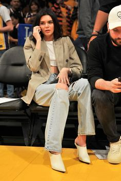 Dressing this super cropped version up, Kendall teamed it with a checked blazer, stiff jeans and white mules, while also debuting a shorter hairstyle.