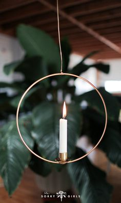 Learn how to make this gorgeous DIY hanging candle holder! Click through for more details.