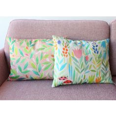 Pink Garden(Left) - The pretty fresh greens of this leaf wander across a soft pink ground on this little pillow; the pink theme continues onto the striped reverse.  Ladybirds(Right) - Two ladybirds on a grassy walk amongst the flowers, with a soft blue leafy reverse.  Originally hand-painted directly onto calico, digital printing faithfully reproduces the freshness of every brushstroke and colour nuance on our 100% cotton.  These designs are cleverly engineered to wrap around giving a…